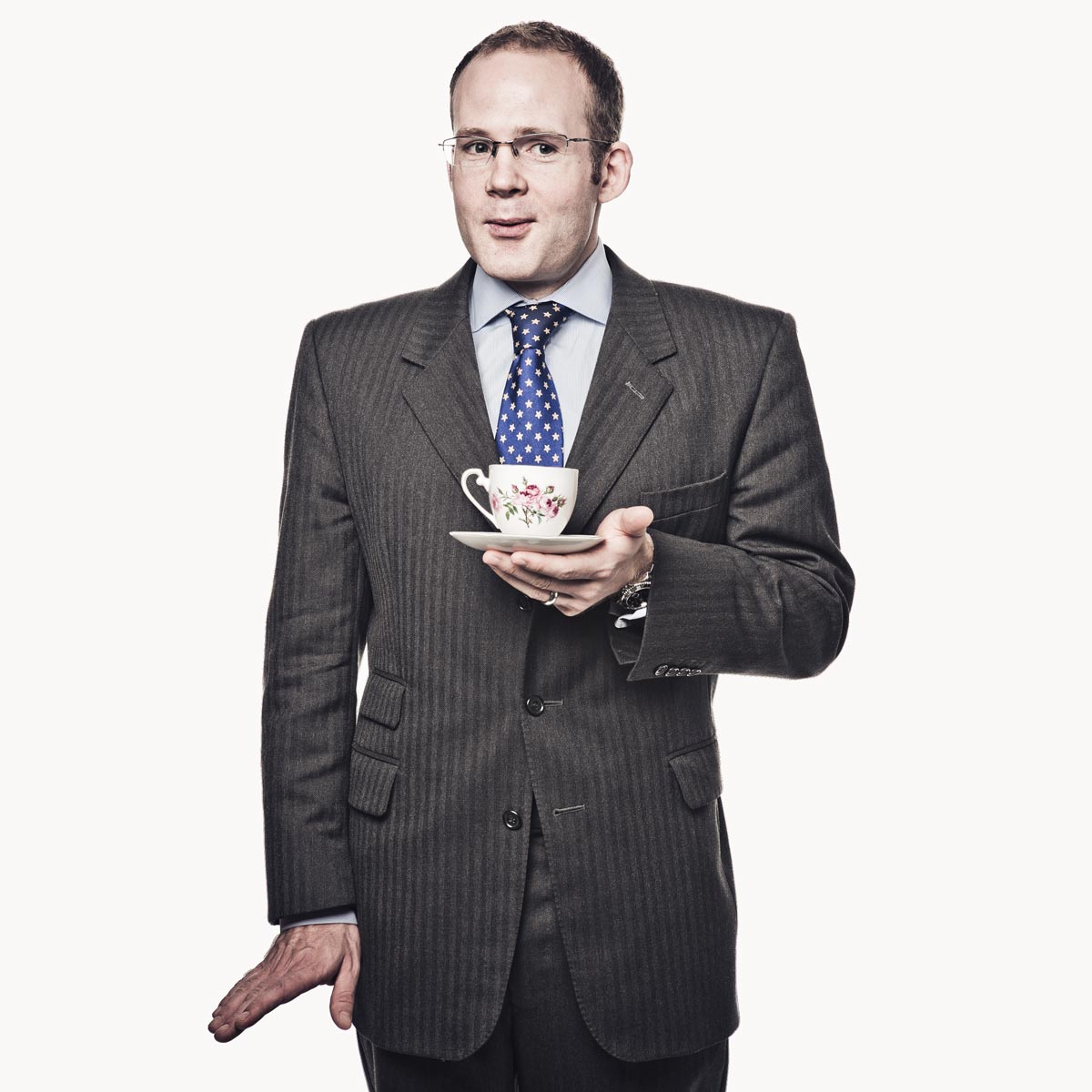 Quirky businessman with teacup