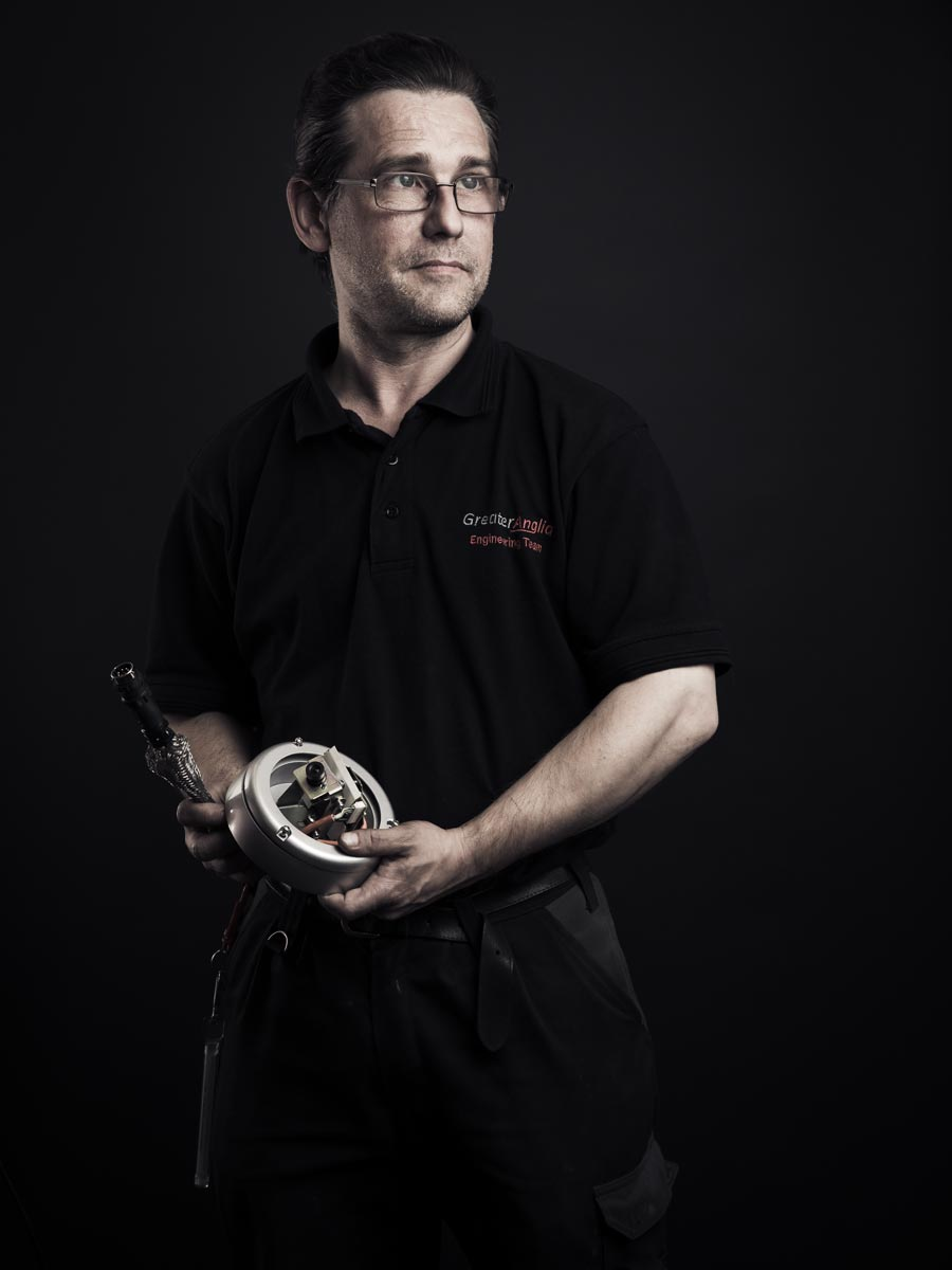 Portrait of man holding tool
