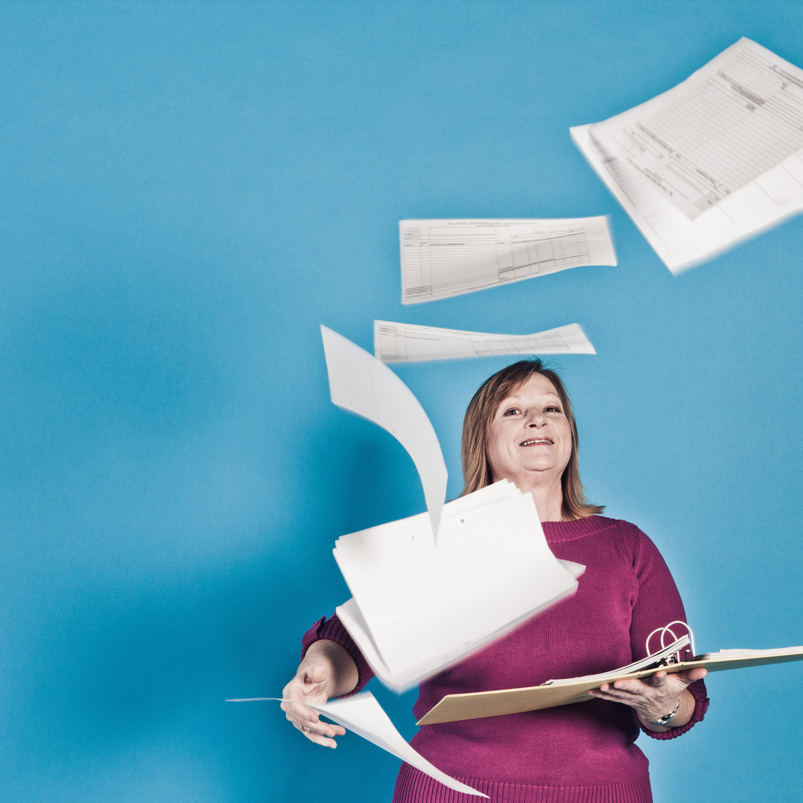 Woman with flying office paper