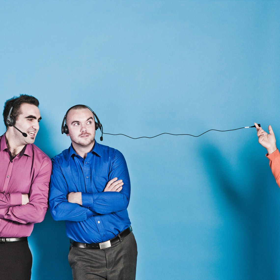 Colourful men wearing headphones