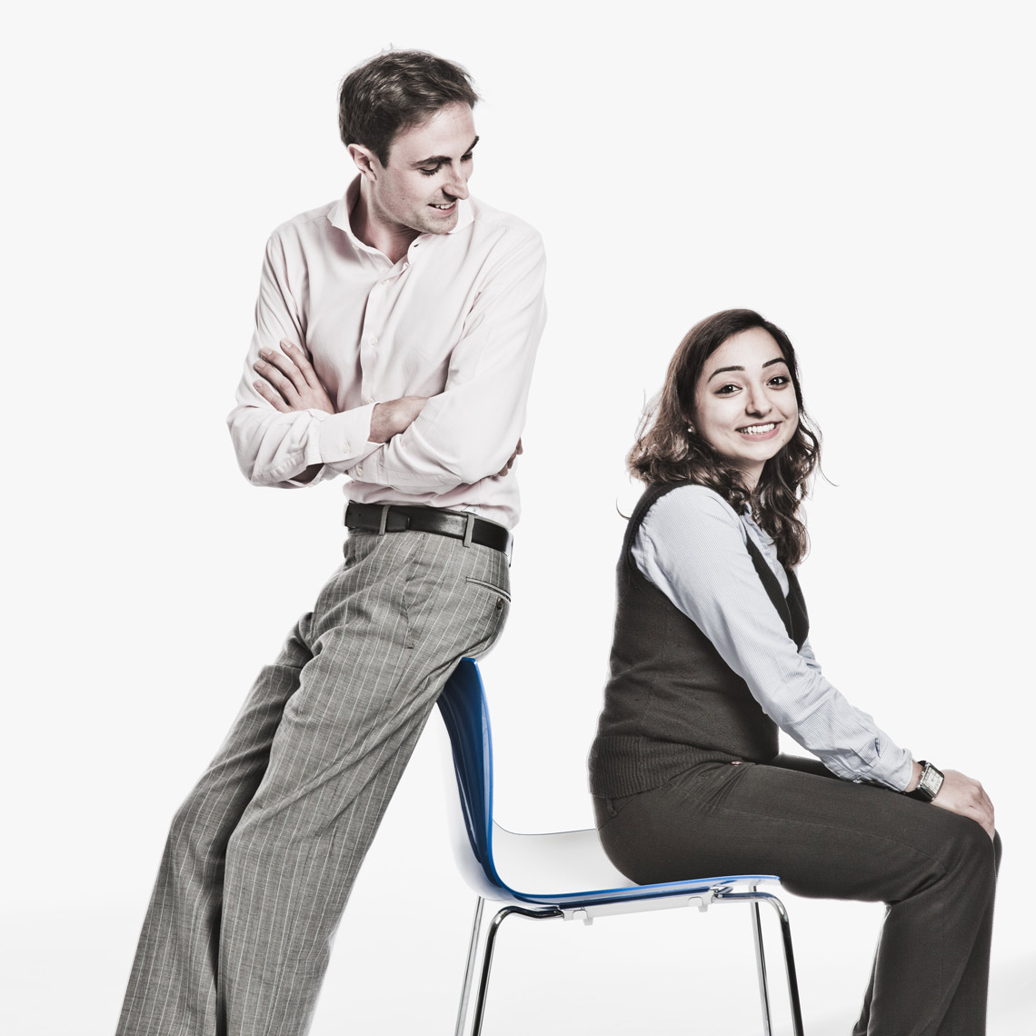 Man and woman sitting on chair