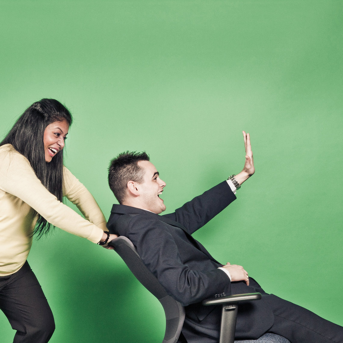 woman pushing man in chair